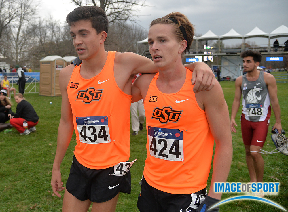Nov 21, 2015; Louisville, KY, USA; Oklahoma State runners Chad Noelle (434) and Brian Gohlke (424) embrace after finishing during the 2015 NCAA cross country championships at Tom Sawyer Park.