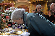 Moscow, Russia, 10/04/2004.&#xD;Russian Orthodox Easter celebrations at the Church of Peter and Paul in central Moscow. Churchgoers kiss icons inside the church.&#xD;<br />