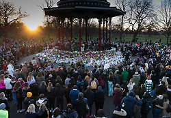 © Licensed to London News Pictures. 13/03/2021. London, UK. People gather during an unofficial vigil at the bandstand on Clapham Common for murder victim Sarah Everard. Metropolitan Police officer Wayne Couzens has been charged with the kidnap and murder of Sarah Everard, who went missing as she walked across Clapham Common in south London. The 33-year-old's body was found in Kent just over a week later. Photo credit: Peter Macdiarmid/LNP
