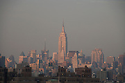 Empire State Building and Mid Town seen from the Brooklyn Bridge New York City