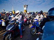22 JANUARY 2019 - PHRA PRADAENG, SAMUT PRAKAN, THAILAND:  Passengers on  motrbikes on a motorcycle and vehicle ferry crossing the Chao Phraya River in Phra Pradaeng. The use of vehicle ferries across the river has gone down as the government has built bridges to connect communities on both sides of the river. The Phra Pradaeng ferries are the busiest vehicle ferries in the Bangkok metropolitan area. Since the BTS Skytrain now comes close to the ferry, the number of commuters going into Bangkok that use the ferry has increased.    PHOTO BY JACK KURTZ