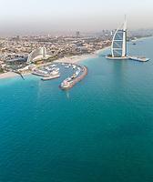 Aerial view of the luxurious Burj Al Arab Hotel And harbour in Dubai bay, U.A.E.
