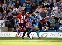 Photo: Richard Lane/Richard Lane Photography. Wycombe Wanderers v Brentford. Coca Cola Fotball League Two. Bentford's Marcus Bean and Wycombe's Tommy Doherty (rt) challenge for the ball.