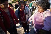 """07 DECEMBER 2010 - PHOENIX, AZ:  Supporters of the DREAM Act say a prayer in front of offices of US Sen. John McCain in Phoenix Tuesday. Dolores Huerta, who started working in the civil rights movement in the 1960's, threw her support behind students fasting on behalf of the DREAM Act in front of Sen. John McCain's office Tuesday. The student picked McCain's office because he used to support the DREAM Act. They hope that the US Senate will pass the DREAM Act during its """"lame duck"""" session. The Senate debated and defeated similar legislation just before the November general election.   PHOTO BY JACK KURTZ"""