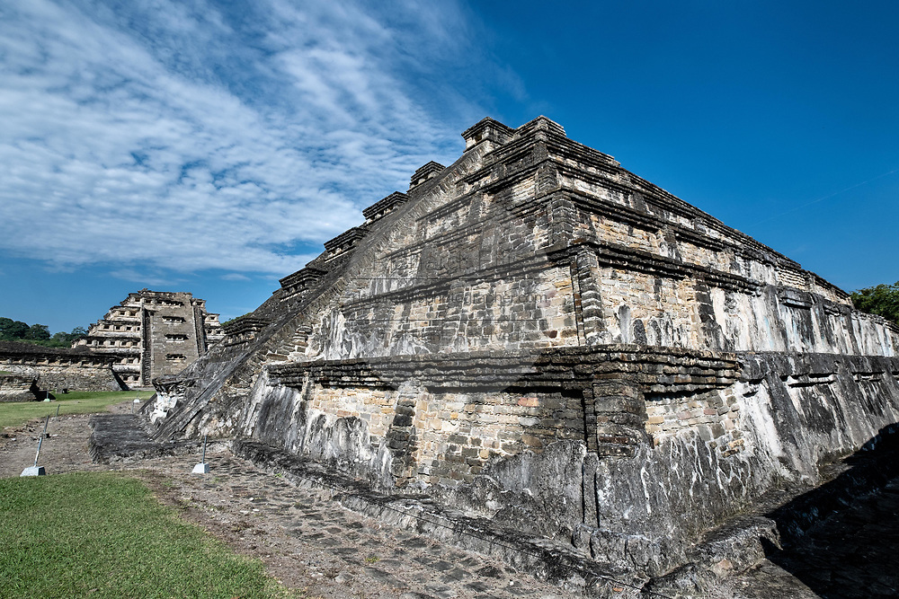 Mesoamerica Blue Temple Pyramid, right, and the Pyramid of the Niches, left, at the pre-Columbian archeological complex of El Tajin in Tajin, Veracruz, Mexico. El Tajín flourished from 600 to 1200 CE and during this time numerous temples, palaces, ballcourts, and pyramids were built by the Totonac people and is one of the largest and most important cities of the Classic era of Mesoamerica.