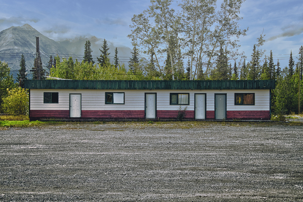 Many Alaska Highway roadhouses evolved from American military camps built during the construction of the 2,700 kilometre highway completed in 1942. Roadhouses typically offered a place to stay, a meal and gas, and were spaced no more than a day's drive apart.<br /> <br /> This image was captured between Whitehorse and Haines Junction.