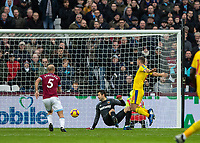 Football - 2018 / 2019 Premier League - West Ham United vs. Crystal Palace<br /> <br /> Lukasz Fabianski (West Ham United) fails to deal with the <br /> cross and James McArthur (Crystal Palace) sneaks in to score the opening goal at the London Stadium<br /> <br /> COLORSPORT/DANIEL BEARHAM