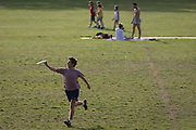 During the UKs Coronavirus pandemic lockdown and in the 24hrs when a further 255 deaths occurred, bringing the official covid deaths to 37,048, <br /> a Londoner catches a frisbee while social distancing in Ruskin Park, a public green space in the south London borough of Lambeth, on 26th May 2020, in London, England.
