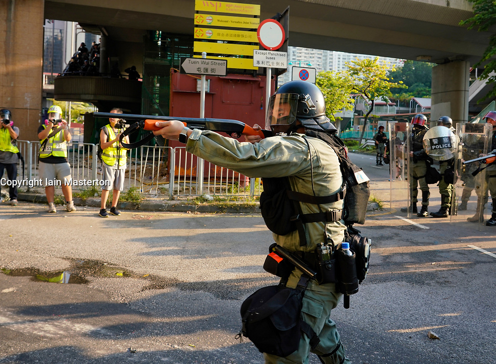 Tuen Mun, Hong Kong. 22 September 2019. Pro democracy demonstration and march through Tuen Mun in Hong Kong. Marchers protesting against harassment by sections of the pro Beijing community. Largely peaceful march had several violent incidents with police using teargas. Several arrests were made. Pictured; Police charge with weapons.  Iain Masterton Live News.