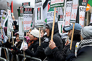 London 04/01/09: Protests outside the Israeli Embassy in London UK: Many braved temperatures of zero degrees call for the end of fighting in Gaza
