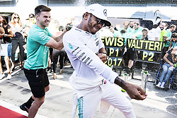 September 3, 2017 - Monza, Italy - A Mercedes AMG Petronas F1 Team member sprays LEWIS HAMILTON with champagne after he won the FIA Formula One Grand Prix of Italy. (Credit Image: © Hoch Zwei via ZUMA Wire)