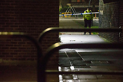 © Licensed to London News Pictures.11/12/2020. London, UK.  Police guard a scene in Newham, south London where a male, believed 15 was fatally stabbed. Police were called at approximately 6:50pm to reports of male stabbed in Woodman Street. Photo credit: Marcin Nowak/LNP