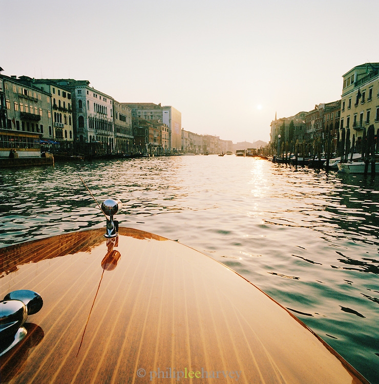 Motor boat on the Grand Canal at sunset in Venice, Italy