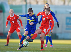 ZENICA, BOSNIA AND HERZEGOVINA - Tuesday, November 28, 2017: Wales' Alice Griffiths and Bosnia and Herzegovina's Dajana Spasojević during the FIFA Women's World Cup 2019 Qualifying Round Group 1 match between Bosnia and Herzegovina and Wales at the FF BH Football Training Centre. (Pic by David Rawcliffe/Propaganda)