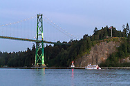 The Paddlewheeler MPV Constitution passes Prospect Point under the Lions Gate Bridge in Vancouver, British Columbia, Canada