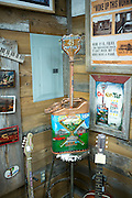 Guitar shape oil can souvenir in gift shop at The Shack Up Inn cotton pickers themed hotel, Clarksdale, Mississippi USA