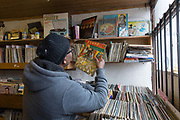 A man searches for vinyl at the Record Detective Agency record shop in Palmers Green on the 27th March 2018 in North London, United Kingdom