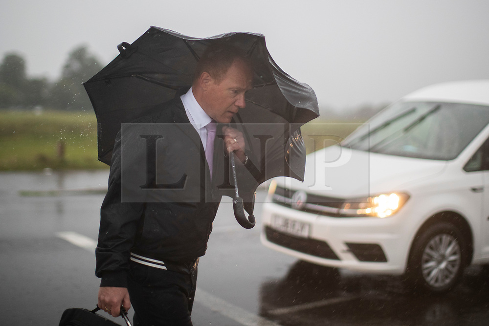 © Licensed to London News Pictures. 01/10/2021. London, UK. A man shelters under an umbrella during heavy rain on Blackheath Common in South East London. Rain showers are forecasted to continue in parts of London and South East England for the rest of the week.  Photo credit: George Cracknell Wright/LNP