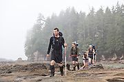 Hikers travel on the exposed continental shelf near Owen Point, West Coast Trail, British Columbia, Canada.