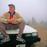 Steve Bechtel waits forlornly on his car near the site where his wife disappeared