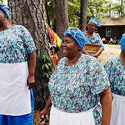From Left, Bertha McKnight, Margie Washington, and Bessie Butler, members of The Geechee Gullah Ring Shouters, of Georgia, laugh during the performance of storyteller Louise Cohen, before heading on stage for their performance during the Gullah Festival at the  Technical College of the Lowcountry on May 24, 2014.