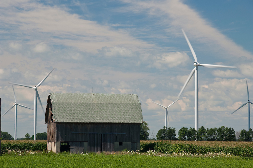 Wind turbines and an old barn on agricultural land near Bad Axe Michigan.