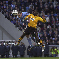 Photo. Glyn Thomas.Digitalsport<br /> Manchester City v Blackburn Rovers. Premiership. <br /> City of Manchester Stadium, Manchester. 17/01/2004.<br /> Blackburn's Andy Cole (R) fights an aerial battle for possession with Richard Dunne.