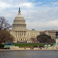 The U.S. Capitol building rises behind the Grant Memorial and Reflecting Pool in Washington, D.C.