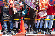 Thousands of Japanese and Myanmar nationals stand on pictures of Genrall Min Aung Klaing as they protest outside the Japanese Foreign Ministry in Tokyo calling for the Japanese government to take action over the recent coup in Myanmar. Kasumigaseki, Tokyo, Japan. Wednesday February 3rd 2021, Many of the protesters held flags of Aung San Suu Kyi's National League for Democracy (NLD), along with portraits of the the detained leader herself and former President, Win Myint.