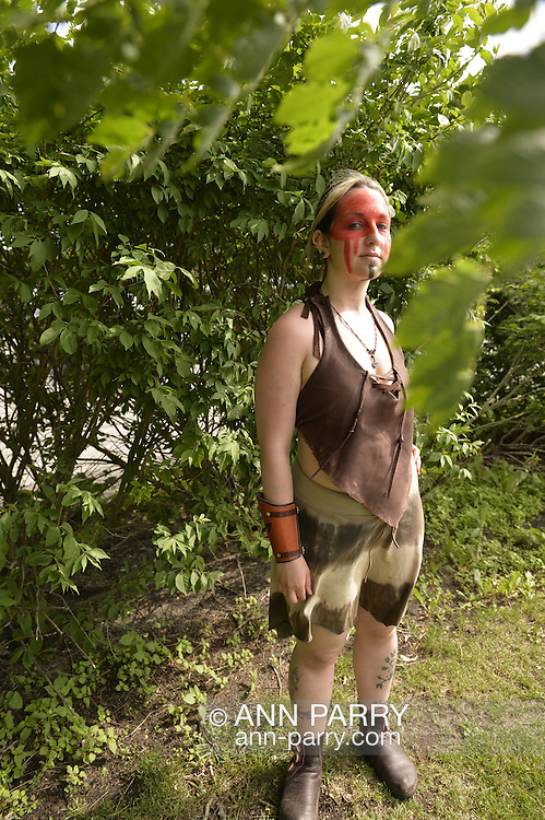 Garden City, New York, U.S. - June 14, 2014 -  ASHLEY MORSE, of Queens, is wearing red and black face paint and a costume of Slania the Dagorhir female warrior, at Eternal Con, the annual Pop Culture Expo, with costumes, Comic Books, Collectibles, Gaming, Sci-Fi, Cosplay, Horror, and held at the Cradle of Aviation Museum on Long Island.