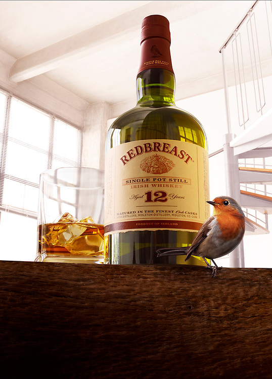 Bottle of Whiskey on a wooden surface with a glass filled with Ice and Whiskey and a Robin in front of the bottle Ray Massey is an established, award winning, UK professional  photographer, shooting creative advertising and editorial images from his stunning studio in a converted church in Camden Town, London NW1. Ray Massey specialises in drinks and liquids, still life and hands, product, gymnastics, special effects (sfx) and location photography. He is particularly known for dynamic high speed action shots of pours, bubbles, splashes and explosions in beers, champagnes, sodas, cocktails and beverages of all descriptions, as well as perfumes, paint, ink, water – even ice! Ray Massey works throughout the world with advertising agencies, designers, design groups, PR companies and directly with clients. He regularly manages the entire creative process, including post-production composition, manipulation and retouching, working with his team of retouchers to produce final images ready for publication.