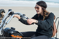 "Kissa Von Addams of the ""Iron Lillies"" riding on Daytona Beach during Daytona Bike Week 75th Anniversary event. FL, USA. Thursday March 3, 2016.  Photography ©2016 Michael Lichter."