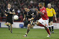 Photo: Pete Lorence.<br />Nottingham Forest v Charlton Athletic. The FA Cup. 06/01/2007.<br />Radostin Kishishev heads the ball forwards ahead of Junior Agogo.
