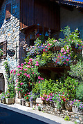 Floral display outside gift and souvenir shop Coup de Coeur in Yvoire by Lac Leman, Lake Geneva, France