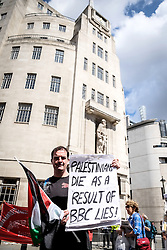 A protester holds up a placard protesting against the BBC at a demonstration in support of Gaza.  London Aug 2014
