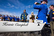 Howard Campbell drinks after christening a new rowing shell prior to the annual Brown Cup regatta between the University of Victoria and University of British Columbia at the Gorge Waterway in Victoria, British Columbia Canada on March 25, 2017.