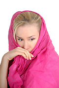 Headshot of a young blond woman with a pink scarf wrapped around her head