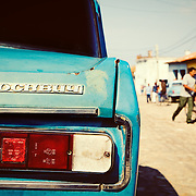 """The rear of a vintage Moskvitch 1500 car on the streets of Trinidad, Cuba. Moskvitch translates to """"Muscovite"""" in English and was a vehicle exported from the Soviet Union in the 1960's."""