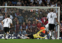 Photo: Lee Earle.<br /> Aston Villa v Fulham. The Barclays Premiership. 21/10/2006. Villa's Gareth Barry (R) beats Fulham keeper Anti Niemi to score from the spot.