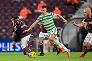Beni Baningime (#6) of Heart of Midlothian FC tackles David Turnbull (#14) of Celtic FC during the Cinch SPFL Premiership match between Heart of Midlothian FC and Celtic FC at Tynecastle Park, Edinburgh, Scotland on 31 July 2021.