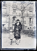 fashionable dressed mother with little girl in a park France circa 1920s