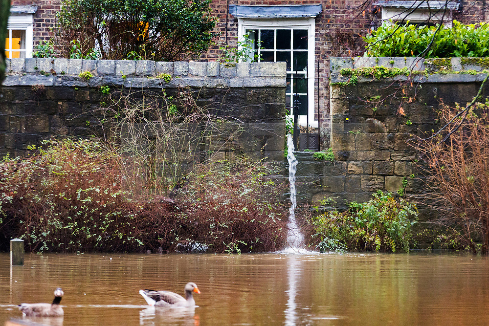 © Licensed to London News Pictures. 05/02/2021. York UK. Water is pumped from a property in York this morning as the River Ouse in York city centre continued to rise over night after breaking its banks yesterday & in now at a height of 3.38m the river is expected to rise further as recent snow melts. Photo credit: Andrew McCaren/LNP