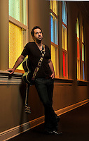 Singer-Songwriter Josh Kelley poses for photos at the Ryman Auditorium on Tuesday, February 8, 2011, in Nashville, Tenn. (AP Photo/Donn Jones)