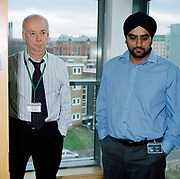 Office workers colin selby left and Partap Rai, right, waiting to take part in an Evac Chair training exercise . From the series Desk Job, a project which explores globalisation through office life around the World.