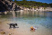 Calvia, Mallorca, Man and dog at Calo d'en Monjo 31-07-2018