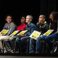 The top five students in the Gallup-McKinley County Schools spelling bee listening to instructions from pronouncer Wade Bell inbetween rounds, Wednesday, Jan. 16 at Gallup High School.