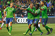 Seattle's Nelson Valdez (16) celebrates with teammates Obafemi Martins (9), Andy Rose (5) and Clint Dempsey (2) after Valdez scored a goal against Los Angeles in the first half  of their MLS soccer western conference knockout round playoff match, Wednesday, Oct. 28, 2015 at CenturyLink Field. (Genna Martin, seattlepi.com)