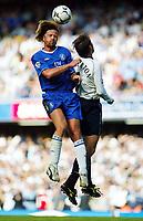 Photograph: Scott Heavey.<br />Chelsea v Tottenham Hotspur from Stamford Bridge. 13/09/2003.<br />Emmanuel Petit outjumps Darren Anderton
