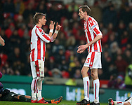 Moritz Bauer of Stoke City talks to Peter Crouch of Stoke City (r). Premier league match, Stoke City v Manchester City at the Bet365 Stadium in Stoke on Trent, Staffs on Monday12th March 2018.<br /> pic by Andrew Orchard, Andrew Orchard sports photography.