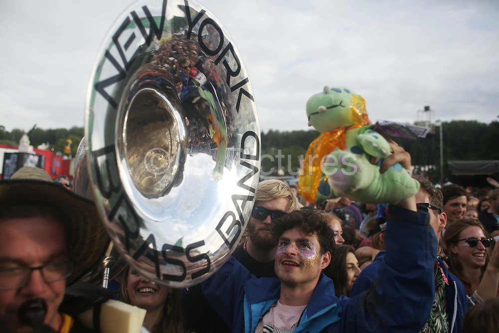 The New York Brass Band performing in the middle of the crowd in front of the Hell stage in Shangri-la at Glastonbury Festival in Glastonbury, United Kingdom. Glastonbury Festival is a five-day festival of contemporary performing arts that takes place near Pilton, Somerset. In addition to contemporary music, the festival hosts many other arts. (photo by Kristian Buus/In PIctures via Getty Images)